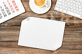 White paper sheet wooden background Office desk coffee