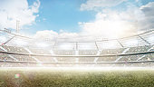 Profesional soccer stadium. Big sport arena. Daytime stadium under the sun with lights, fans and flags. Background