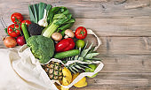 Fresh vegetables fruits cotoon bag Tomato cucumber broccoli pineapple avocado