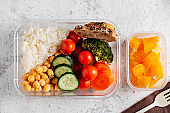 Healthy food in lunch box, on working table with working elements