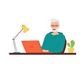 Happy smiling gray-haired elderly man is sitting at a table with a laptop. Concept for remote work and education from home, e-learning, retraining for active retired seniors. Vector illustration
