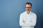 Man in white shirt and glasses with arms crossed