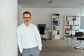 Relaxed successful businessman in spacious office