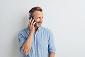 Casual man standing chatting on his mobile