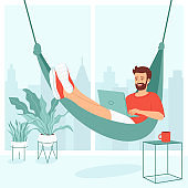 Concept for remote work, freelancing, teaching, e-learning, from home office. Young man is lies in a hammock with a laptop in a room with a large window and houseplants. Vector illustration