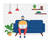 Young smiling man is sitting with laptop on the sofa. The concept of remote work from home, distance learning, programming, freelance. Vector illustration in a flat style.