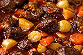 Beef Stew with carrot and baby potato in iron cast pan