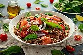 Buckwheat salad with smoked salmon, cherry tomato, red onion and greens