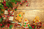 Christmas background with gift box, gingerbread cookies,