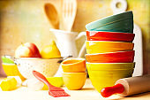 Kitchen cooking utensils background with ceramic multi- colored bowls