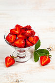 Ripe strawberries on a wooden table.