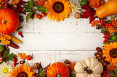 Autumn composition with pumpkins, sunflowers, leaves and berries