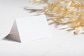 Mockup template with dry plants flower and perfume and design element design for wedding rsvp, thank you card, greeting