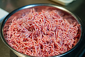 Close up image of bunch of minced flesh in a bowl.