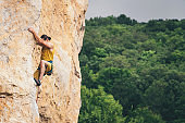Man climbs a rock.