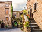 Idyllic inner alley of Civita di Bagnoregio, ghost mediaeval town built above a plateau of friable volcanic tuff, Lazio, central Italy