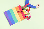 LGBTQ pride rainbow flag tote bag in a hand