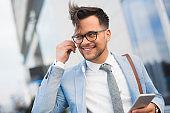 Handsome businessman with earphones