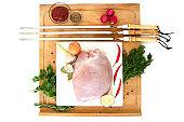 raw turkey meat, fillet for roasting on skewers. Barbecue preparation. ingredients