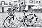 Bicycle ready for sharing on the empty Navona Square in Rome. Italy.