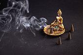 Zen meditation inspiration aromatic cone burning and creating smoke