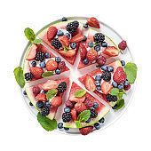 Sliced watermelon pizza isolated