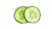 Fresh cucumber slices on white background