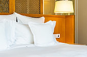 Comfortable white pillow on bed decoration in bedroom