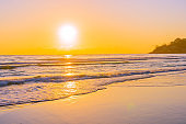 Beautiful tropical beach sea ocean with sunset or sunrise for travel vacation