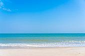 Beautiful tropical sea ocean around beach with blue sky white cloud