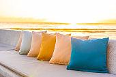 Comfortable pillow on sofa chair around outdoor patio with sea ocean beach view