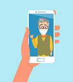 Vector of hand holding smartphone chatting with elderly family member wearing face mask via video call app