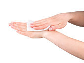 Woman hand use antibacterial wet wipes or tissue isolated on a white background
