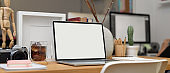Office desk with laptop, stationery, office supplies and decoration in office room, clipping path.