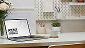 Home office desk with laptop, supplies, decorations and copy space, clipping path