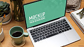 Workspace with laptop, coffee mug and stationery in home office, clipping path