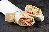 traditional oriental shawarma in Eco-friendly cardboard. dark stone surface. concept of eco packages of recyclables.