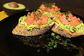 French loaf bruschetta with salmon and herbs