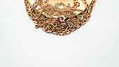 Jewelry. Gold chains and a beautiful golden box on a white background. Jewelry concept