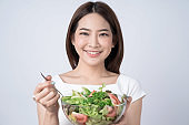 Healthy lifestyles, Asian women holding a salad bowl of fresh vegetables, Good and healthy organic food.