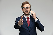 businessman talking on the phone ready to shake hands
