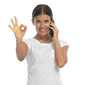 Positive casual woman talking on phone and gesturing perfect