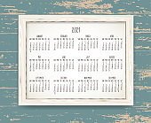 Year 2021 monthly calendar in a wooden frame