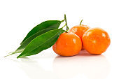 Ripe tangerines with green leaves
