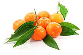 Group of ripe tangerines with green leaves