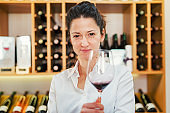 Front view close up of beautiful caucasian woman with glass of wine