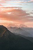 Landscape sunset Mountains peaks and clouds summer travel wild nature scenic aerial view