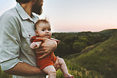 Father walking with baby outdoors family lifestyle dad and child together summer vacations parenthood childhood concept Fathers day holiday