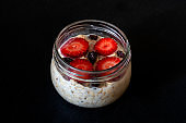 Overnight oats with fruit against black
