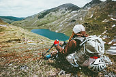 Backpacker in mountains relaxing Travel Lifestyle survival concept adventure outdoor active vacations